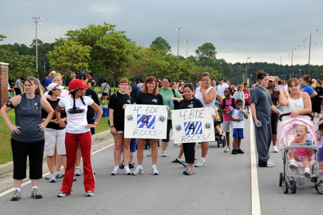 """Spouses and children of 4th IBCT Soldiers assemble at the corner of 6th Street and Gulick Avenue before the """"Yellow Ribbon Walk"""" begins, Aug. 14."""