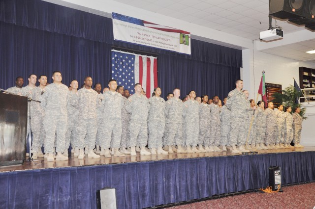 Members of the 591st Medical Logistics Company line up on stage during a deployment ceremony Aug. 11 at Army Community Service.