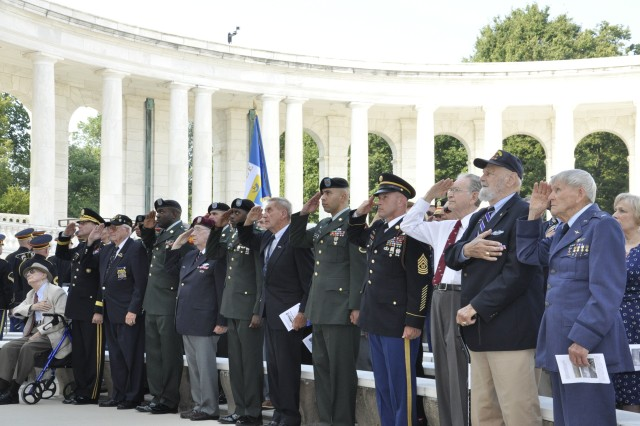 Veterans and Soldiers render salute at the memorial ceremony marking the 66th anniversary of Operation Dragoon, the Allied invasion of Southern France that began Aug. 15, 1944. Members of the 3rd Infantry Division, as well as veterans from 7th Army, XII Tactical Air Command, the 8th Fleet, and representatives from countries that participated in the 90,000-troop amphibious landing gathered to honor those who participated in the World War II operation, Aug. 8-10.