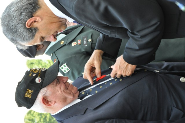 Dr. François Rivasseau, deputy French Ambassador to the U.S., pins the French Legion of Honor medal, the highest decoration bestowed by France, on Col. (Ret.) Douglas Dillard, a veteran of the 3rd Infantry Division who fought in Operation Dragoon during World War II.