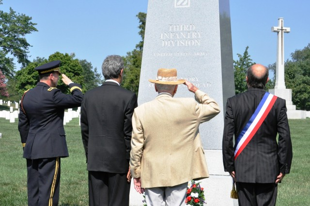 Brigadier General Jeffrey Phillips, 3rd Infantry Division deputy commanding general-rear; Dr. François Rivasseau, Deputy French Ambassador to the U.S.; Col. (Ret.) Henry Bodson, a Marne Division Operation Dragoon veteran; and Jacques Bompard, a representative from France; render salute at the 3rd ID monument at Arlington Cemetery during the 66th anniversary of Operation Dragoon, Aug. 10. Members of the Society of the 3rd ID, veterans from 7th Army, XII Tactical Air Command, the 8th Fleet, and representatives from countries that participated in the 90,000-troop amphibious landing gathered to honor those who participated in the World War II operation.