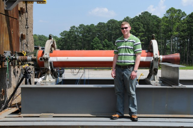 Zachary Dixon stands next to a recently fired FMS PATRIOT Advanced Capability-2 Rocket Motor at Redstone Test Center TA-5.  Test data was gathered for an FMS customer to determine if the motor was still in usable life mode.