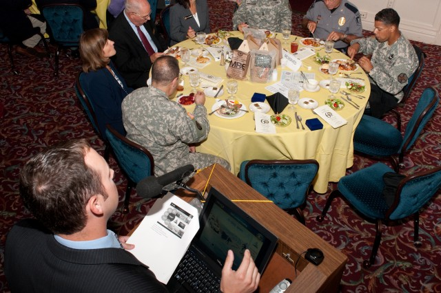Jeremy Whitsitt, program outreach and education coordinator for the Department of Defense Combat Feeding Directorate at Natick Soldier Research, Development and Engineering Center, gives a presentation Aug. 17 at the Association of the U.S. Army-Aberdeen Chapter luncheon at Top of the Bay.