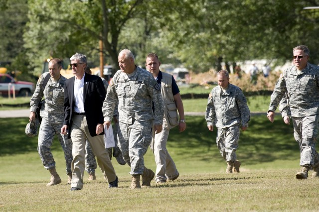 Secretary of the Army John McHugh is given a tour of Muscatatuck Urban Training Center by Maj. Gen. R. Martin Umbarger, Indiana National Guard adjustant general, Aug. 18, 2010.