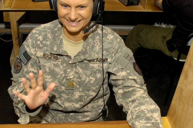 <b>Baghdad –</b> Maj. Lyn Rogers, a budget officer with the Iraq Training and Advisory Mission Director, uses the MWR Internet Cafe at Forward Operating Base Union III in Baghdad, Iraq, regularly to Skype with family and friends. On Aug. 3 she attended her 25th high school reunion via Skype.