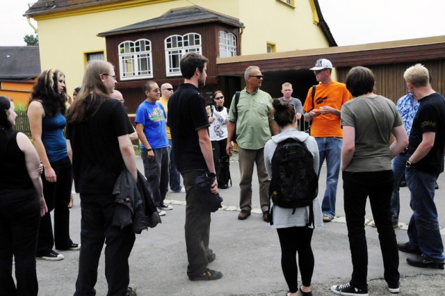 Students from the Berufliche Oberschule in Hof and Soldiers from U.S. Army Grafenwoehr's Better Opportunity for Single Soldiers program tour the village of Moedlareuth, July 23, for a day of cultural exchanges, history lessons and practicing foreign language skills.
