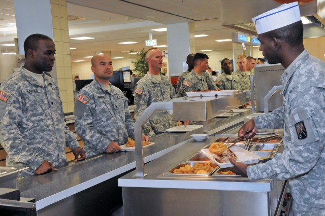 Soldiers wait in line for their orders at the short order bar during the lunch rush at the Grafenwoehr Main Post Dining Facility, Aug. 9. The Grafenwoehr facility won first place for large dining facilities in the Philip A. Connelly Awards Program at Installation Management Command-Europe level. They will compete again at the Department of the Army level in December.