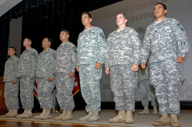 Seven Soldiers from the 7th Special Forces Group were awarded the Silver Star during a ceremony at the JFK Auditorium Monday, for their valorous actions while deployed to Afghanistan between 2007 and 2008. From right: Sgt. 1st Class Mario Pinilla, Staff Sgt. Daniel Gould, Sgt. 1st Class Jonathan Clouse, Master Sgt. Julio Bocanegra, Sgt. 1st Class Antonio Gonzalez, Chief Warrant Officer 2 Mark Roland, and Spc. Rene Nunez, a member of the 82nd Airborne Division who accepted the posthumous award for his brother Sgt. 1st Class David Nunez.