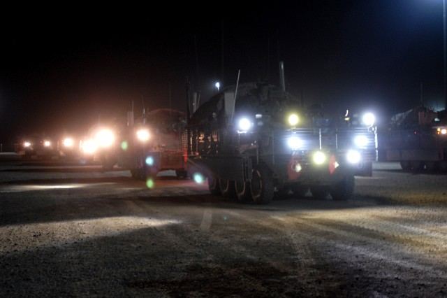 Stryker armored vehicles with 4th Stryker Brigade Combat Team, 2nd Infantry Division, line up at a fueling site here Aug. 17 to receive fuel before heading out on a two-day mission to exit Iraq through Kuwait, the same way American troops entered the country nearly seven years ago.