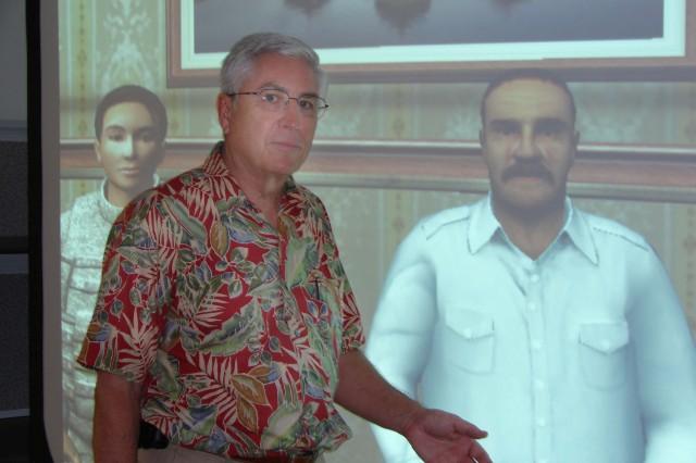 SCHOFIELD BARRACKS, Hawaii - Richard Wight talks with Wahid Amir (right rear), while Nadia (left rear), the interpreter, provides the English-Arabic translations.
