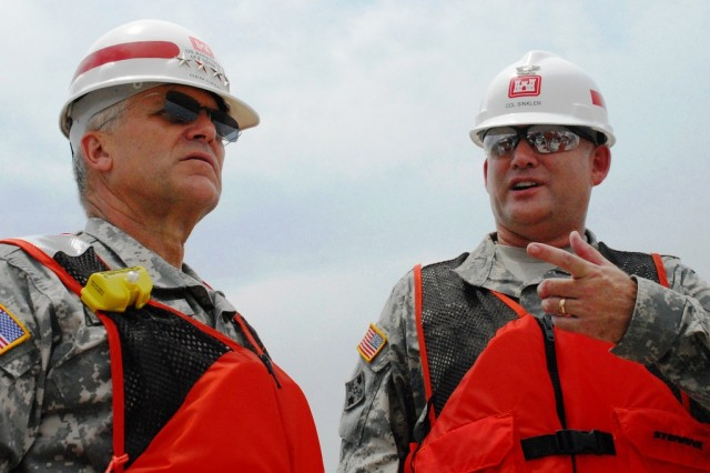 Gen. George Casey, U.S. Army Chief of Staff, listens to Col. Robert Sinkler, commander of the U.S. Army Corps of Engineers New Orleans District, during a visit to the Corps' hurricane protection projects.