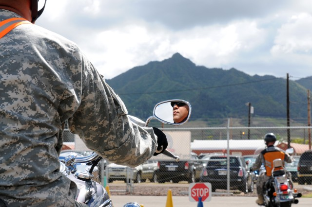 SCHOFIELD BARRACKS, Hawaii - A student at the motorcycle safety course, allows himself plenty of distance from the rider in front of him, before maneuvering the course.