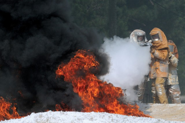 Advanced Individual Training students use the chemical agent Purple K Powder to douse flames at Fort Lee's Petroleum and Water Department Training area..  The instruction is part of the petroleum supply specialist course taught by the Quartermaster School.