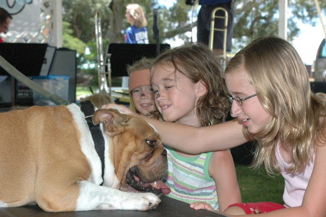 SCHOFIELD BARRACKS, Hawaii - Children interact and socialize with dogs competing in the show during the daylong event held on Sills Field, Aug. 14.