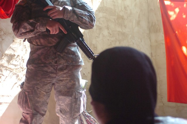 Upon entering a make-shift hut, Sgt. Martin Busch, a human intelligence collector, HHC, 2nd Brigade Combat Team, 82nd Airborne Division, is confronted with an Iraqi role-player with Reservoir International who claims her husband had been captured by insurgents. The situation, designed to improve the Paratroopers information gathering skills, took place during a training exercise near Fort Bragg, NC, Aug. 4. (U.S. Army Photo by Staff Sgt. Seth Laughter, 2BCT PAO NCOIC)