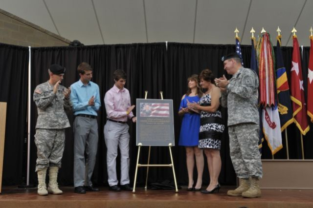 (Left to right) U.S. Army Recruiting Commander Maj. Gen. Donald Campbell, Nolan and Mark Eastman, Jessica Eastman, Laura Eastman, and Fort Knox Commander Lt. Gen. Benjamin Freakley unveiled the placque memorializing the new park in the late Col. Mark Eastman's name.