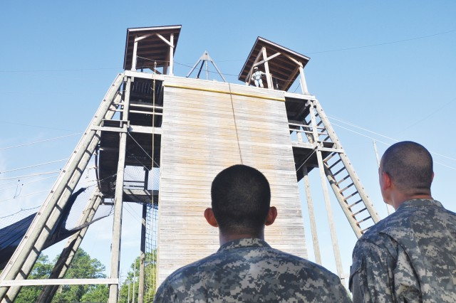 Two Soldiers from B Company, 1st Battalion, 378th Infantry Regiment, gaze up at Eagle Tower at the start of the Aug. 17 training session.