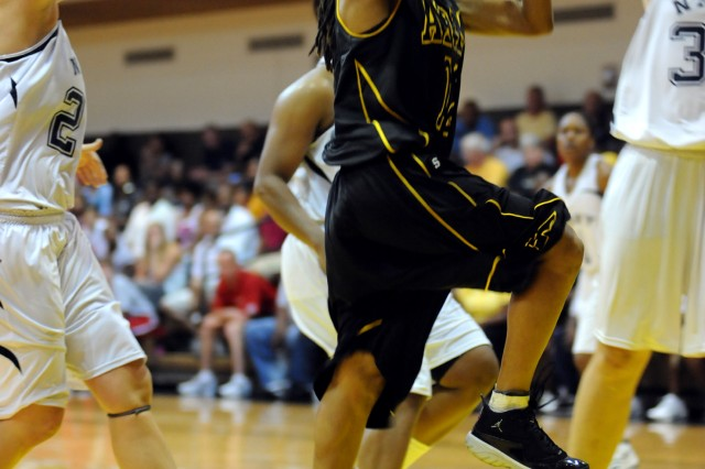 Spc. Ashley Bowman of Fort Meade, Md., drives for two of her 15 points during All-Army's 56-53 victory over All-Navy in the women's finale of the 2010 Armed Forces Basketball Championships Aug. 22 at Joint Base Fort Myer-Henderson Hall, Va.