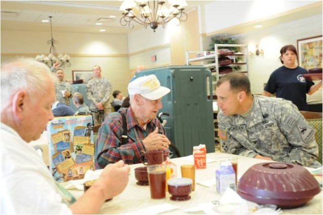 Col. Scott McKean, commander of the 4th Brigade Combat Team, 1st Armored Division converses with Arther Craft, center, and Harlod Self, left about their time in the Armed Forces and the current things McKean and the Highlanders are doing for the community and the U.S. Army. Self and Craft are both veterans, Craft form the U.S. Army and Self from the U.S. Navy. (U.S. Army photo by 1st Lt. Chad Cooper, 4th Brigade Combat Team, 1st Armored Division public affairs)