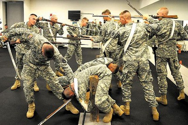 Soldiers reenact the Battle of Trenton Aug. 3 at the Fort McNair Fitness Center in preparation for a Spirit of America tour in September that will take them to Pennsylvania, Kentucky and Michigan for a show about the history of the U.S. Army.