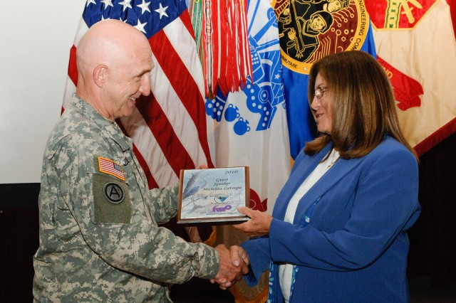 """ABERDEEN PROVING GROUND, Md. - Community members gathered to observe Women's Equality Day at the Edgewood Conference Center here Aug. 23.  Aberdeen Proving Ground Commanding General Maj. Gen. Nick Justice gave opening remarks to a crowd of about 100 people assembled for the event. Guest speaker Michelina LaForgia told the group about the importance of Women's Equality Day.  This year is the 90th anniversary of women's right to vote. In August 1920, the United States ammended the Constitution granting the right to vote. In 1978, Congress designated August 26 as Women's Equality Day to honor women's successful campaign to win the right to vote and their continuing efforts toward equality.  <a href=""""http://www.flickr.com/photos/rdecom/sets/72157624672342333/"""">More photos...</a>"""