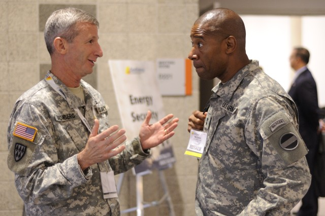 Maj. Gen. Howard B. Bromberg (left), former Fort Bliss commanding general and now the special assistant to the U.S. Army Forces Command commanding general at Fort McPherson, Ga., talks to Maj. Gen. Dana J. H. Pittard, Fort Bliss commanding general, after an energy security panel on the first day of this year's GovEnergy conference held Aug. 16 through 18 at the Dallas Convention Center. The workshop and tradeshow joined federal agencies like the Department of Defense with private-sector industry partners in the government's effort to reduce carbon emissions and make use of renewable and alternative energy sources.