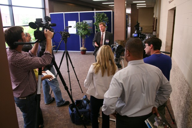 Huntsville Mayor Tommy Battle answers media questions Tuesday about his announcement during the 13th Annual Space and Missile Defense Conference of establishing a cyber security research center in Huntsville.