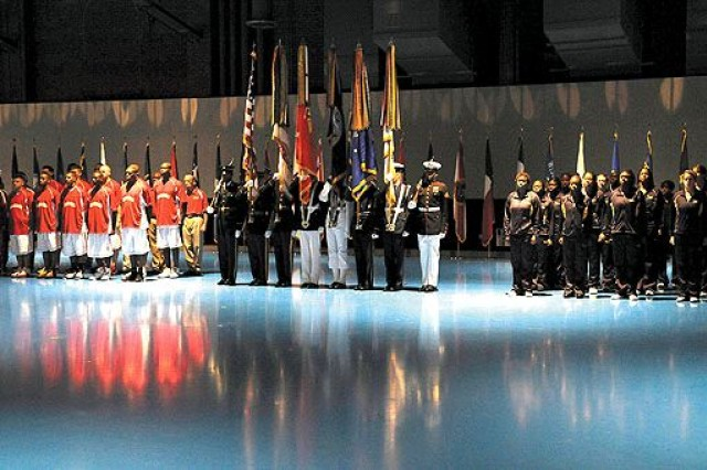 The All-Marine women's and men's basketball team, the U.S. Joint Forces Color Guard and the All-Navy women's and men's basketball team stand at attention during the playing of the national anthem at the opening ceremony of the Armed Forces Basketball Tournament at Joint Base Myer-Henderson Hall's Conmy Hall Aug. 16.