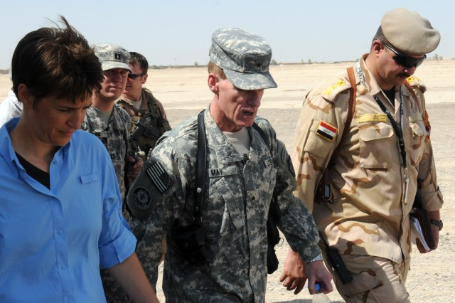 Rachel Maddow (foremost left), a television host for MSNBC, Brig. Gen. Bradley W. May, Director, Iraq Training and Advisory Team, United States Forces-Iraq, and Iraqi Army Col. Abbas Fadhil Sahib (right), Besmaya Combat Training Center commander,  walk and talk about the Iraqi Army Aug. 19 at the BCTC, Iraq.