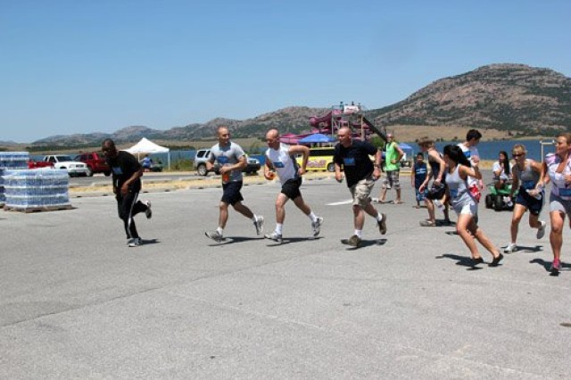 Athletes in the Amazing Fitness Race take off from the starting point as the air horn blows. The event was part of the 95 Days of Summer Finale at Lake Elmer Thomas Recreation Area on Fort Sill, Okla.