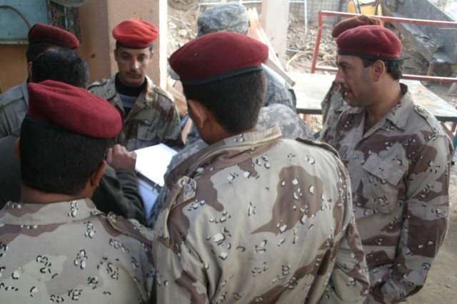 Students review vehicle schematics during a self-taught portion of a five-day humvee maintenance course. The Iraqi Army mechanics were advised by Soldiers from 121st Brigade Support Battalion, 4th Brigade, 1st Armored Division, deployed from Fort Bliss, Texas. The Iraqi Army has taken over a large portion of its own training, but the advise and assist brigades still provide them with support when requested.