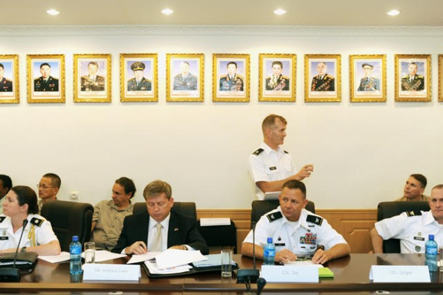 U.S. military and Mongolian Armed Services members brief Mongolian Armed Forces Deputy Chief of Staff Brig. Gen. Byambasuren Bayarmagnai on future plans for Khaan Quest 2011. The discussion was part of a Senior Leader Seminar Aug. 18 in Ulaanbaatar, Mongolia. Participants in the event represented the Mongolian Armed Forces, U.S. Defense Attaché Office, Department of the Army Headquarters, U.S. Army Pacific Command (USARPAC), Marine Forces Pacific and Alaska National Guard.