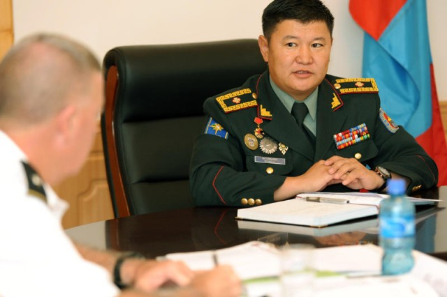 Mongolian Armed Forces Deputy Chief of Staff Brig. Gen. Byambasuren Bayarmagnai, right, discusses issues with Brig. Gen. John E. Seward, deputy commanding general, U.S. Army Pacific Command at a Senior Leader Seminar in Ulaanbaatar, Mongolia Aug. 18. The seminar provided an opportunity for the generals to exchange ideas on the relationship between the U.S. and Mongolian militaries at a strategic level.