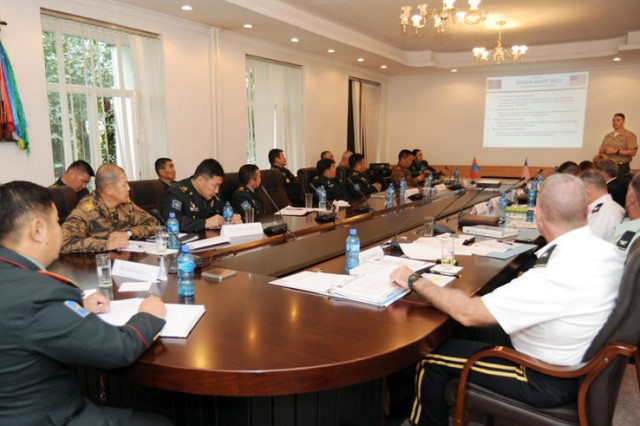 Alaska National Guard Lt. Col. Stephen Wilson briefs Mongolian Armed Forces Deputy Chief of Staff Brig. Gen. Byambasuren Bayarmagnai on upcoming state partnership events involving the Alaska National Guard and Mongolian Armed Forces Aug. 18 in Ulaanbaatar, Mongolia. The seminar offered a forum for senior leaders to discuss topics of mutual concern and establish a framework to shape upcoming exercises and other security cooperation activities.