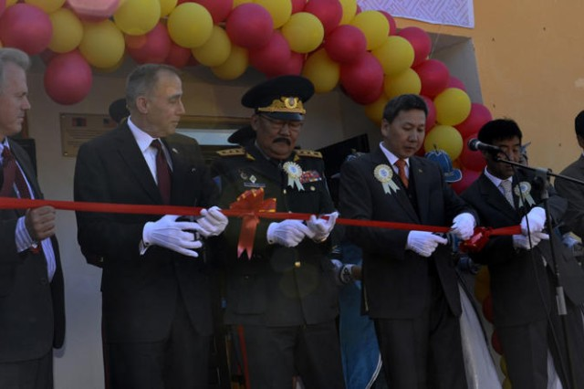 Distinguished guests celebrate the opening of a newly constructed bath house with a ribbon cutting ceremony during the facility dedication in Songinokhairkhan, Ulaanbaatar on Aug 20. Pictured are: Nicholas Hill, U.S. Charge D' Affaires to Mongolia, left; Wallace Gregson, Assistant Secretary of Defense - Asian and Pacific Security Affairs; Lt. Gen. Berendejid Byambajar, Mongolian Armed Forces Chief of General Staff; Luvsanvadan Bold, Minister of Defense of Mongolia; Gombosuren Munkhbayar, Mayor of Ulaanbaatar; and Mr. Bold, Chairman of Songinokhairkhan district. The bath house was a humanitarian and civic assistance project built by members of the 797th Engineering Company (Vertical) from Barrigada, Guam and members of the Mongolian Armed Forces.
