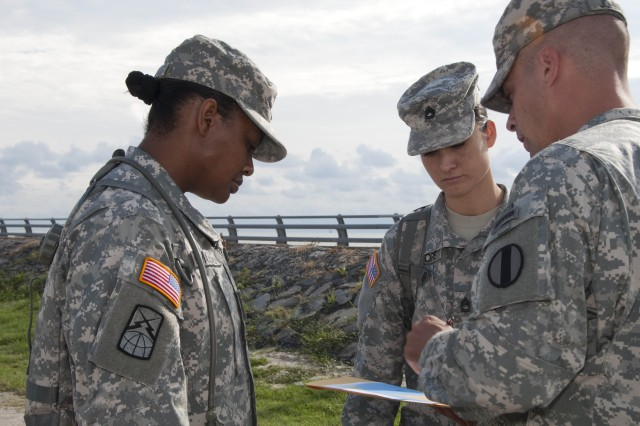 Sgt. 1st Class Michael Johnston, 2009 active component Drill Sergeant of the Year, instructs Sgt. 1st Class Lesley Moore, a competitor from Fort Gordon, and Sgt. 1st Class Alexia Moore, a competitor from Fort Bragg, N.C., during the 2010 AIT Platoon Sergeant of the Year Competition on Fort Monroe, Va., August 25. The competitors were tested on soldier-level training and MOS introduction. (U.S. Army photo by Sgt. Angelica Golindano) (RELEASED)