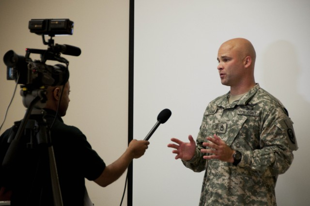 Sgt. 1st Class Jason Lamb, a competitor from Fort Eustis, Va., is interviewed during the 2010 AIT Platoon Sergeant of the Year Competition on Fort Monroe, Va., August 25. The competitors were tested on soldier-level training and MOS introduction. (U.S. Army photo by Sgt. Angelica Golindano) (RELEASED)