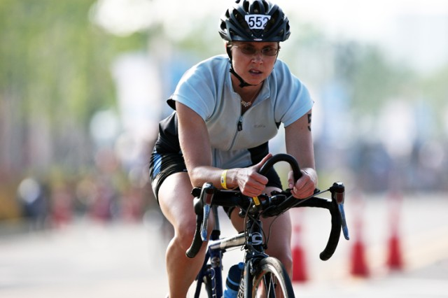 INCHEON, South Korea - Sarah Stahl from Headquarters and Services Company, 602nd Aviation Battalion, Humphrey Garrison, makes her way through the 40-kilometer bike race segment of the 2010 Incheon Asian Continental Cup Triathlon Aug. 22 at Songdo Central Park in Incheon. Stahl finished first in the women's 18-29 year old division in 3 hours, 5 minutes and 45 seconds.