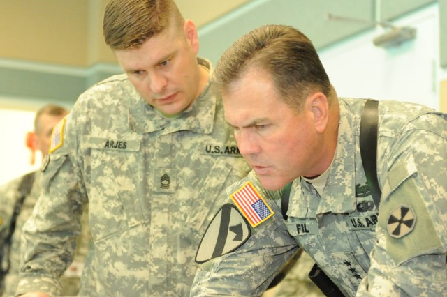 Eighth Army Commander Lt. Gen. Joseph F. Fil, Jr., (right) is briefed during exercise Ulchi Freedom Guardian 2010.