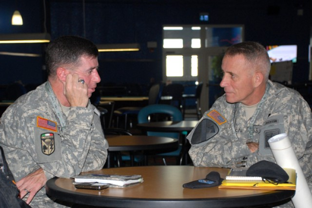 Col. Joseph L. Ingignoli (left), U.S. Army Reserve, and Lt. Col. Alfred Padden, Department of the Army, discuss issues Aug. 26 on the sidelines of the Theater Army Security Cooperation Conference presently being hosted by U.S. Army Africa in Vicenza, Italy. Presentations by and discussions among U.S. embassy and country team representatives, U.S. Africa Command and a wide range of Army command and program representatives will conclude Friday.