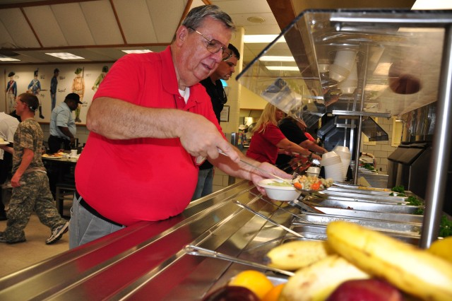 "Retired Master Sgt. Ronald Evans dines at the Drill Sergeant School dining facility while participating in the ""Come See Your Army"" tour Aug. 19. Evans delivered bread to dining facilities across Fort Jackson while serving as"
