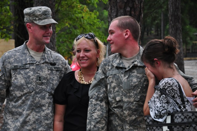 """Maj. Gen. James Milano, Fort Jackson's commanding general, poses with Pvt. Jordan L'Heureux, his mother, Shelly Caron, and his fiancee, Sylvanna Lacasse, as they visit the Confidence Course during the """"Come See Your Army"""" tour. L'Heureux is a Soldier in Basic Combat Training with Company B, 2nd Battalion, 60th Infantry Regiment, who just happened to be training on the course the day of the tour."""