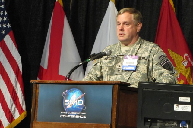 """Lt. Gen. John Gardner, deputy commander of the U.S. European Command, carries the message of collaboration and synergy at the 13th annual Space and Missile Defense Conference through his comments on regional missile defense on Aug. 17. The theme for this year's conference was """"Enabling Regional Warfighters."""""""