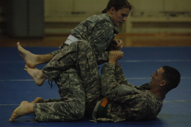 Sgt. Nicole Jenkins, a correction officer with United States Army Regional Correctional Facility-Europe, 95th Military Police Battalion, 18th MP Brigade, a native of Foxborough, Mass., competes in combatives during the National Capital Region Noncommissioned Officer of the Year competition where she placed third overall as the only female in a field of 14 NCOs.