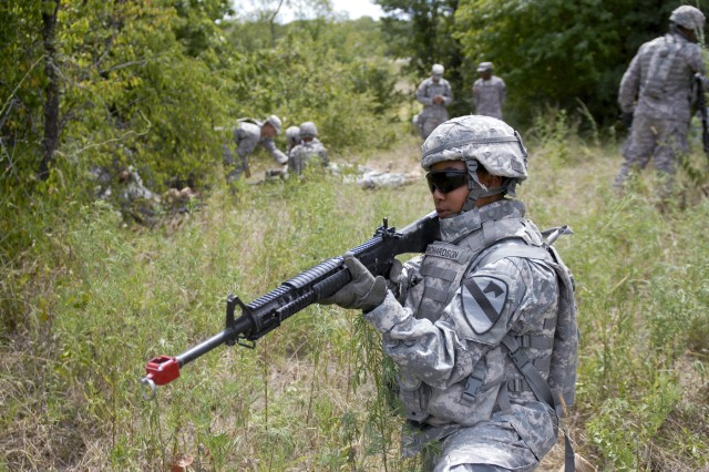 FORT HOOD, Texas-Pfc. Michelle Richardson, a supply specialist with 215th Brigade Support Battalion, 3rd Brigade Combat Team, 1st Cavalry Division, maintains outer security, Aug. 24, during a training exercise while her comrades treat simulated casualties at a casualty collection point.