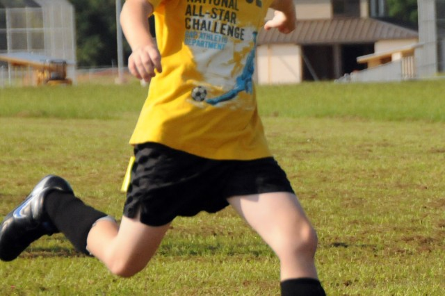 Jacob Burrow kicks a goal at the CYSS youth soccer evaluations Aug. 21 at the CYSS soccer fields. Burrow played at Fort Bragg, N.C., last season and will play in the 8- to 10-year-old division at Fort Rucker.
