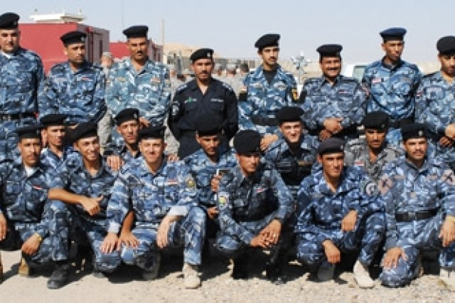 Iraqi Police graduates of Anbar's first 12-week Counter Explosive Team course gather for a class photo at the Ramadi Training Center, Aug. 21.