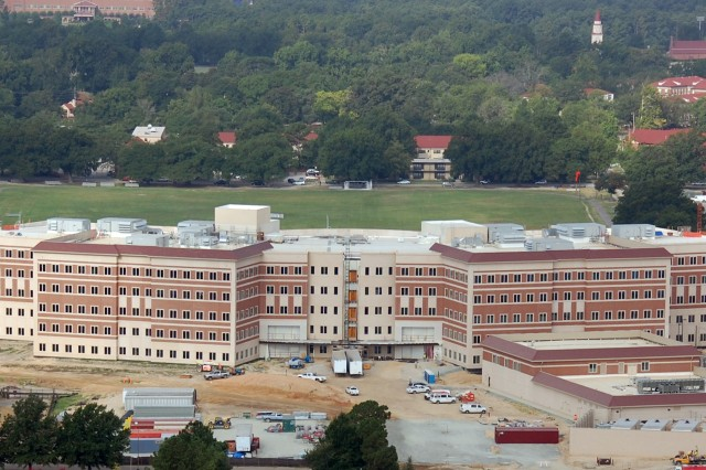 Aerial view of the rear of the U.S. Army Forces Command and U.S. Army Reserve Command Combined Headquarters Construction Project, taken from a U.S. Army, UH-60 Black Hawk helicopter, Aug. 18 2010. The building is approximately 70 percent complete and on schedule for delivery to the U.S. Army, June 21, 2011.