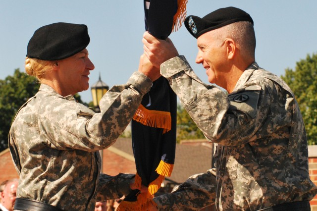 Gen. Ann E. Dunwoody, commander, Army Materiel Command, passes the Military Surface Deployment and Distribution Command colors to Maj. Gen. Kevin A. Leonard during the SDDC change of command. Dunwoody commanded SDDC from 2002-2004.