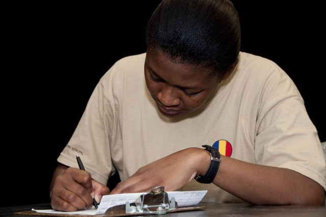 Sgt. 1st Class Lesley Moore, a Washington, N.C. native, writes an essay as part of the 2010 AIT Platoon Sergeant of the Year Competition on Fort Monroe, Va., August 26. (U.S. Army photo by Sgt. Angelica Golindano) (RELEASED)